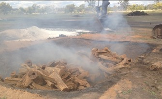Smoking Charcoal Pit
